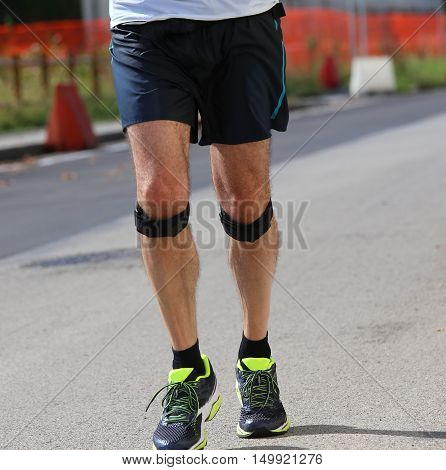 Runner During The Race With The Bandage
