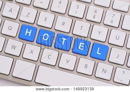 Hotel in blue on a white keyboard