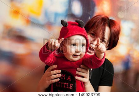 Toddler With Her Mother In A Suit Imp