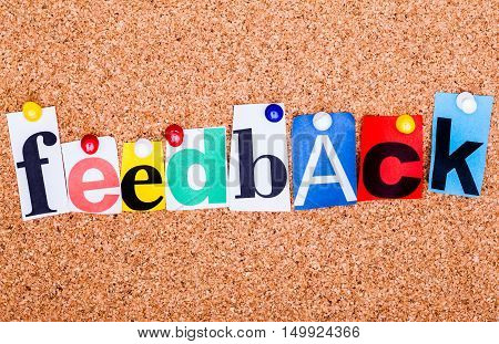 The Word Feedback In Cut Out Magazine Letters Pinned To A Cork Notice Board..