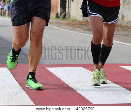 Runners During A Marathon Race In The City On A Pedestrian Crossing