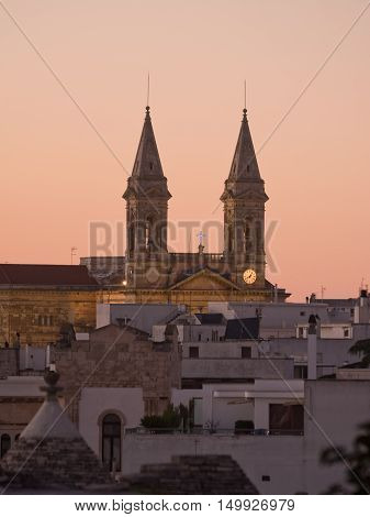 twin Tower of church Alberobello at sunset (Italy)
