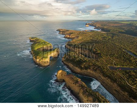 Aerial View Of Mutton Bird Island Arches And Elephant Rock At Sunrise