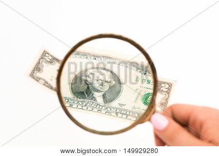 The two dollars bill and magnifying glass
