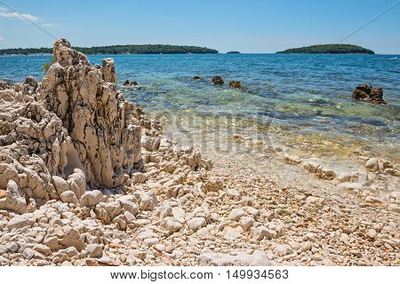 Beautiful rocky beach, bue sea and islands in Istria, Croatian coast
