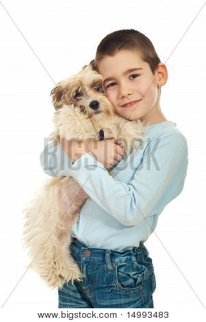 Happy Kid Holding His Puppy