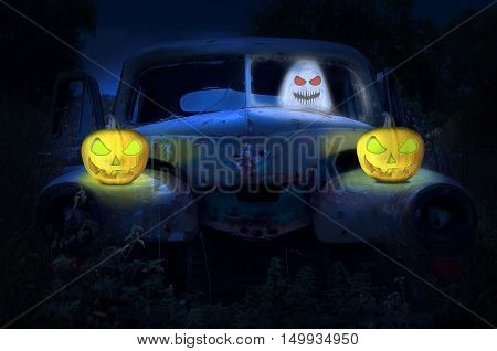 Old abandoned rustic car with ghost and pumpkins. Halloween concept.