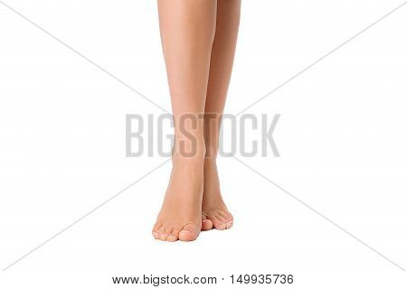 Bare legs of woman isolated on white. Beautiful skin. Foot care