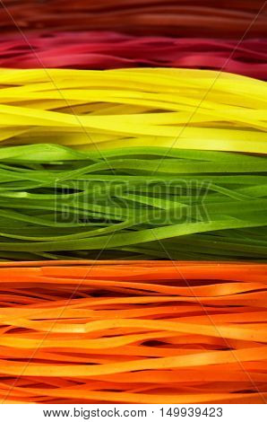 Multi Colored Pasta On A Full Frame. Vertical