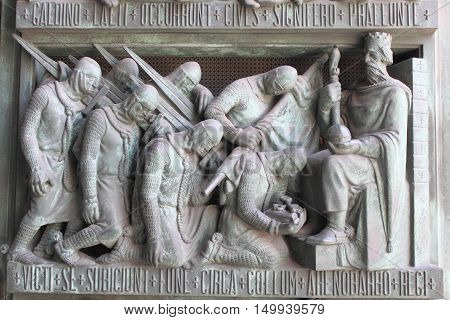 A medieval basrelief with king and knights