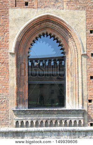 Medieval window in the Sforzesco castle of Milan, Italy