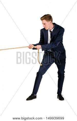 Young businessman pulling a rope isolated on white background