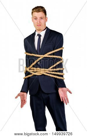 Young businessman in a suit tied up with rope