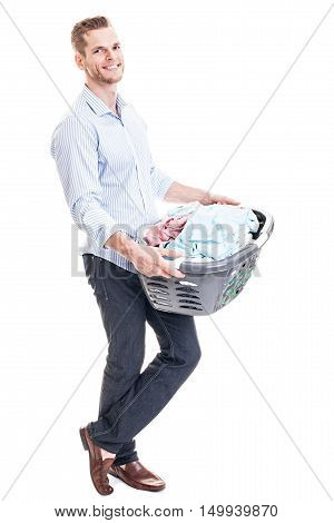 Cheerful Young Man Holding A Basket With Laundry - Isolated On White..