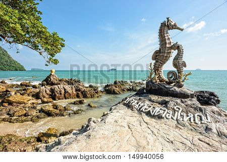 Chumphon Thailand - December 31 2014: Seahorse Statue and Golden Jar Statue on seashore - Landmark at newly famous traditional home stay village Baan Tong Tom Yai Chumphon Province Thailand.
