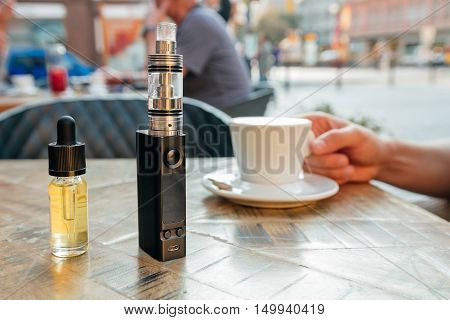 Vape Or Electronic Cigarette And E-liquid On The Table