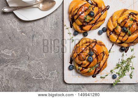 Homemade pumpkin cinnamon yeasted buns, fall baking concept, top view
