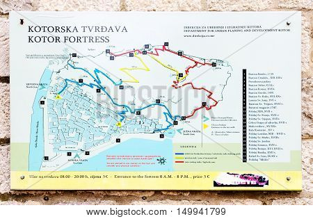 KOTOR MONTENEGRO - SEPTEMBER 21 2015: Plan of Kotor fortress on stone wall of ancient building Kotor Montenegro