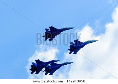 Nizhniy Tagil, Russia - July 12. 2008: Team work of russian fighters SU-27 knights. Display of fighting opportunities of equipment with application of aviation means of defeat. RAE exhibition