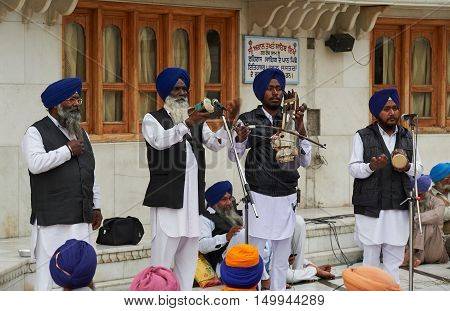 AMRITSAR INDIA - February 18 2015: Indian musicians playing local instruments at Golden Temple (Harmandir Sahib also Darbar Sahib). Golden Temple is the holiest Sikh gurdwara located in city of Amritsar