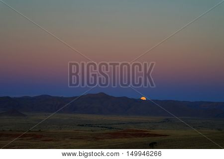 Full moon ascends over the dune in Namib desert