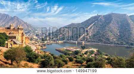 Indian travel famous tourist landmark - panorama view of Amer (Amber) fort and Maota lake, Rajasthan, India