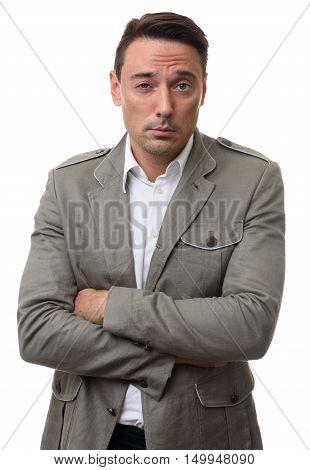 Pensive Casual Man Squinting And Looking At Camera