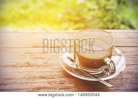 In the morning black coffee on the wooden floor.