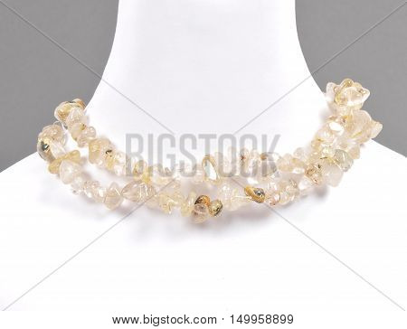 Colorful and crisp image of splintered rutile quartz chain on bust