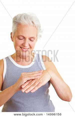 Senior Woman Lubing Her Hands
