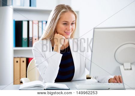 Young business woman with computer in the office
