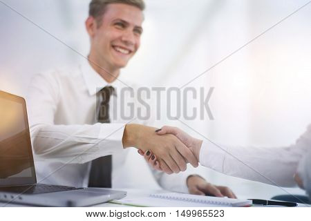Hand shake at the end of a business meeting