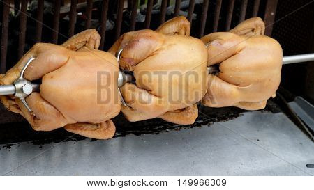 three roast chicken in the big  room