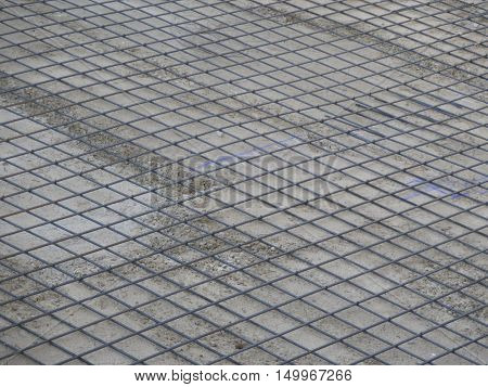 Steel mesh on concrete base ready for poring second layer of concrete
