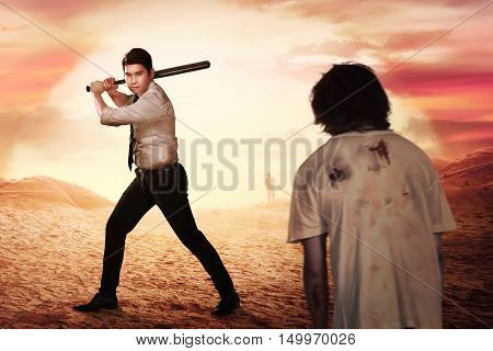 Asian Man With Formal Wear Holding Stick Bat Want To Hit Zombie Man