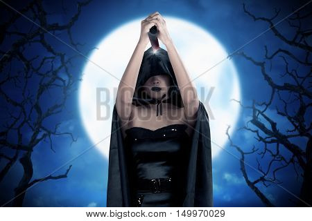 Evil Expression Of Beautiful Dark Woman With Sharp Knife