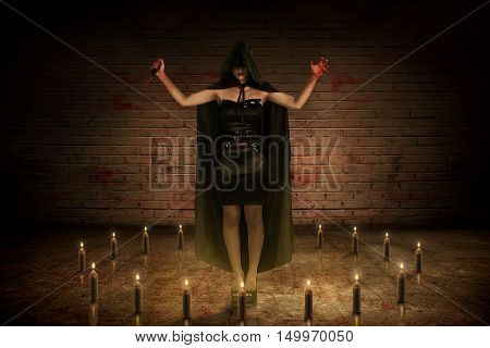 Scary Asian Witch Woman With Bloody Knife And Hand Standing On The Center Of Circle Candle