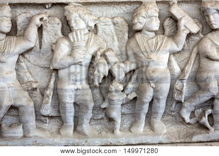 ROME, ITALY - JUNE 12, 2015: Relief on the ancient sarcophagus in the baths of Diocletian in Rome. Italy