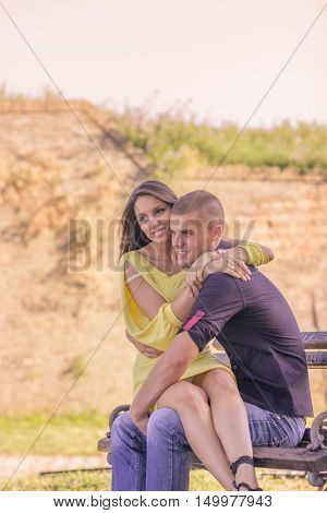 Girl Sitting In Lap Couple Sunny Day Smile
