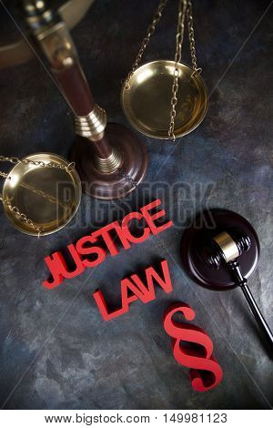 Judges wooden gavel, on wooden table background