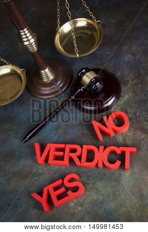 Law theme, mallet of the judge, justice scale, wooden desk background