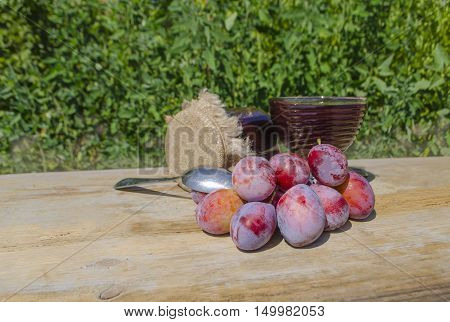 Jar With Plum  Over Wood Background