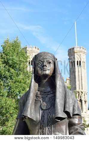 Statue of Queen Bertha Canterbury Kent with towers