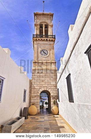 clock tower in front of the church of Dormition at Hydra island Greece