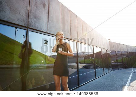 Businesswoman Walking With Coffee