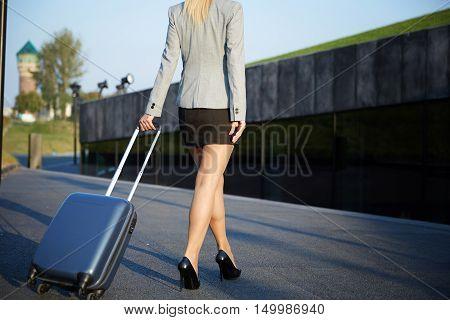 Businesswoman Walking Down The Street