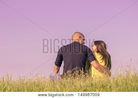Young Couple Hugging Back Rear View Low Angle Sky Grass