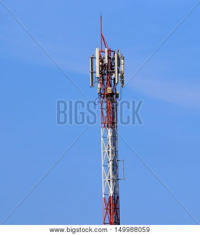 red and white cell phone tower with antenna for a cellular network, south of Songkhla, Thailand