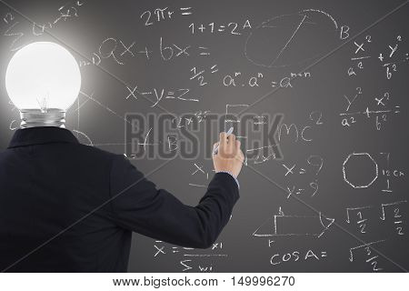 businessman with lighbulb in head standing and hand drawing inspiration or idea brainstorming on blackboard background.