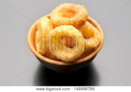 onion ring on background, junk food, fast food, unhealthy and fattening